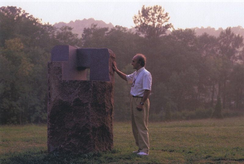 Eduardo Chillida with Lo profundo es el aire, Estela IX [How Pround is the Air; Stele IX] (granite, 1989) © Zabalaga Leku. Photo Jordi Belver. The Estate of Eduardo Chillida. San Sebastian, VEGAP, 2020